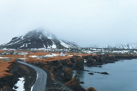 Photo for Road and houses and scenic fjord and mountains in iceland - Royalty Free Image