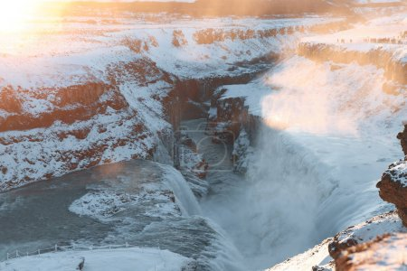 Photo for Majestic snow-covered icelandic landscape with Gullfoss waterfall and rocks at sunrise - Royalty Free Image