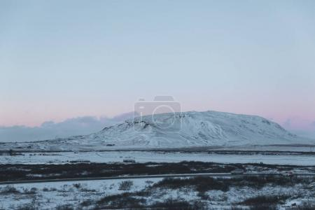 beautiful natural scene with snow-covered mountain and sky at sunrise, iceland