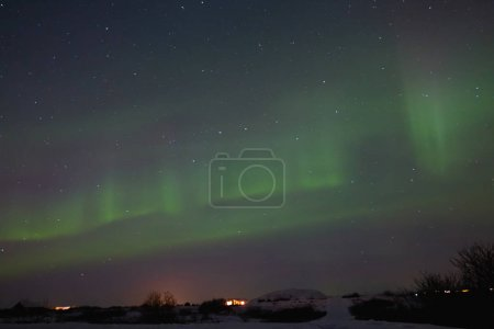 Photo for Beautiful night view of houses under sky with majestic northern lights in iceland - Royalty Free Image