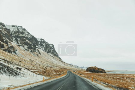 Photo for Beautiful icelandic landscape with rocky hills and empty asphalt road - Royalty Free Image