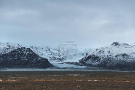 Photo for Beautiful scenic landscape with snow-covered rocky mountains, iceland - Royalty Free Image