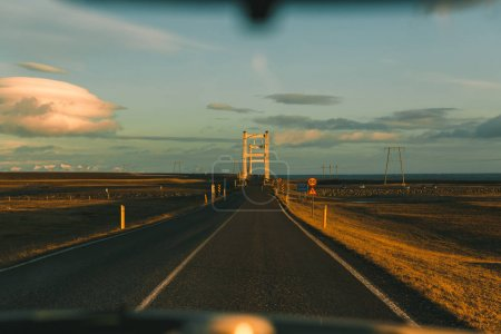 Photo for Pov from car on asphalt road at sunset in iceland - Royalty Free Image