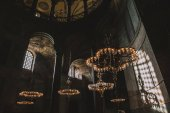 ISTANBUL, TURKEY - OCTOBER 09, 2015: low angle view of chandeliers in suleymaniye mosque