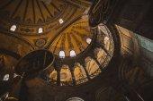 ISTANBUL, TURKEY - OCTOBER 09, 2015: low angle view of interior of illuminated suleymaniye mosque