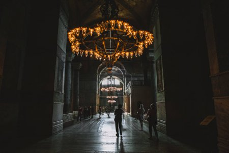 Photo for ISTANBUL, TURKEY - OCTOBER 09, 2015: tourists walking under chandelier in suleymaniye mosque - Royalty Free Image