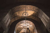 ISTANBUL, TURKEY - OCTOBER 09, 2015: low angle view of arch in illuminated suleymaniye mosque