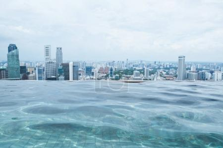 Photo for SINGAPORE - JAN 19, 2016: beautiful view of city skyscrapers and water pool on roof - Royalty Free Image