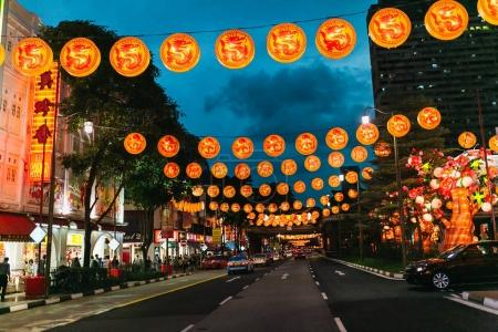 Photo for SINGAPORE - JAN 19, 2016: view of city street decorated with lanterns at night - Royalty Free Image