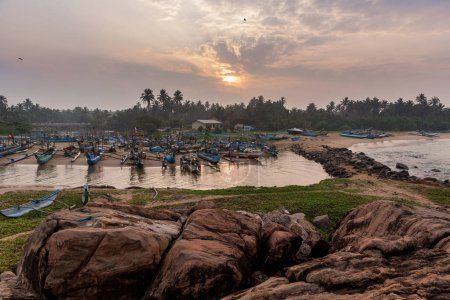 Photo for Beautiful sunset over boats on water, hikkaduwa, sri lanka - Royalty Free Image