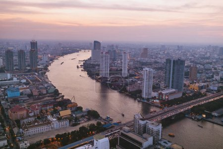 Photo for Aerial view of sunset over skyscrapers and river in bangkok, thailand - Royalty Free Image