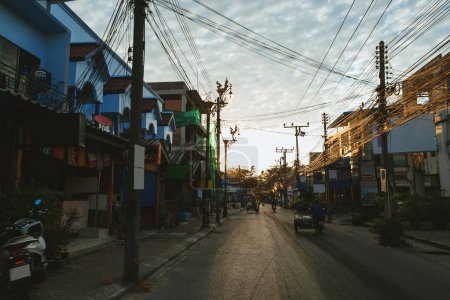 Photo for Urban scene of city street of phuket at sunset - Royalty Free Image