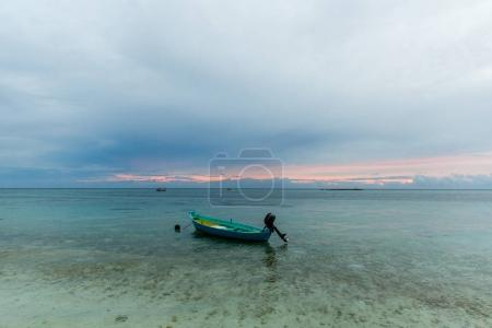 Photo for THODDOO, MALDIVES - JAN 17, 2017: scenic view of empty boat on water, Asia - Royalty Free Image