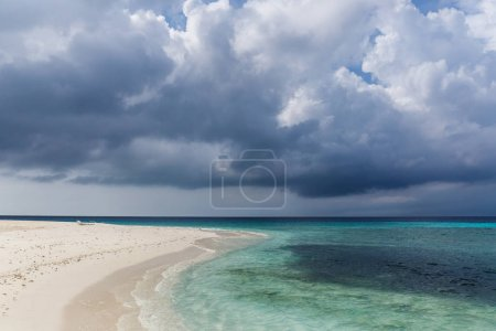 Photo for Scenic view of coastline and dark cloudy sky, maldives, thoddoo - Royalty Free Image