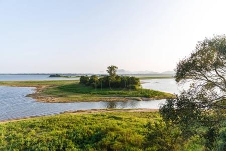 Photo for Beautiful scenic view of river, green trees and clear blue sky, sri lanka, minneriya - Royalty Free Image