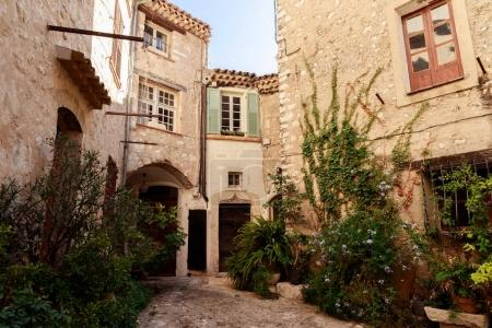 Photo for Facades of ancient stone buildings at old european town, Antibes, France - Royalty Free Image