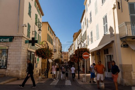 Photo for ANTIBES, FRANCE - 17 SEPTEMBER 2017: street at Antibes full of unrecognizable people in evening - Royalty Free Image