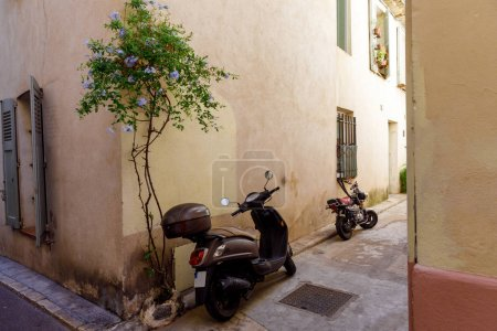Photo for ANTIBES, FRANCE - 17 SEPTEMBER 2017: motorcycles parked on narrow street of old european town, Antibes, France - Royalty Free Image