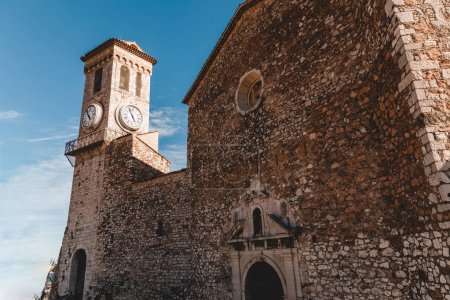 Photo for Ancient stone church with clock tower at old european city, Cannes, France - Royalty Free Image