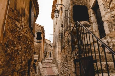 Photo for Narrow street with ancient buildings at old town, Eze, France - Royalty Free Image