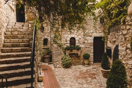 Photo for Stairs at small atrium of ancient stone building, Eze, France - Royalty Free Image