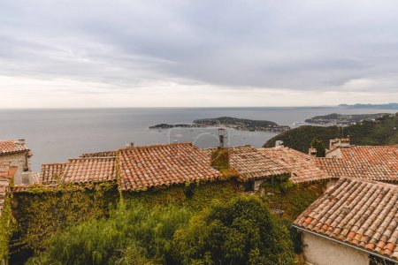 Photo for Rooftops of houses on hill over seashore, Eze, France - Royalty Free Image