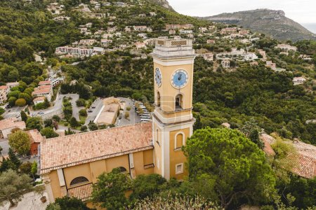 Photo for Aerial view of church with bell tower and clock at small european town on hills, Eze, France - Royalty Free Image