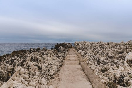 Photo for Trail on rocky coast on cloudy day, Nice, France - Royalty Free Image