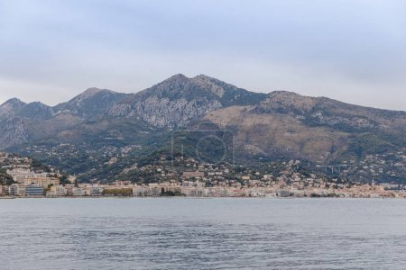 Photo for Coastal city under rocky mountain on cloudy day, Nice, France - Royalty Free Image