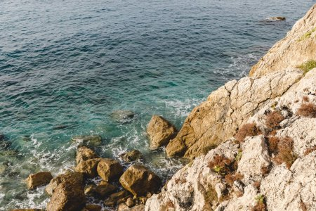 Photo for Aerial view of small waves crashing on rocky cliff, Nice, France - Royalty Free Image
