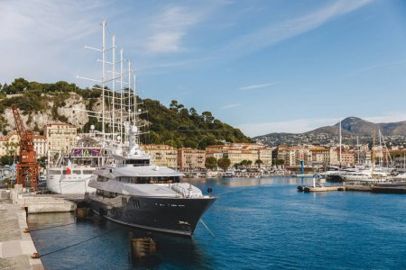 Photo for NICE, FRANCE - 17 SEPTEMBER 2017: luxury yacht in harbour of old european city located on seashore - Royalty Free Image
