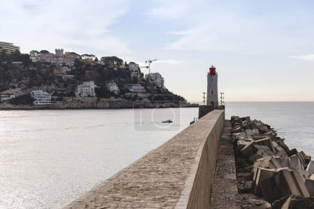 Photo for Scenic lighthouse in harbour of small european town, Nice, France - Royalty Free Image