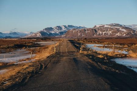 Photo for Empty rural road and snow-covered mountains in iceland - Royalty Free Image