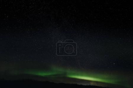 Photo for Majestic view of night sky with aurora borealis and stars in iceland - Royalty Free Image
