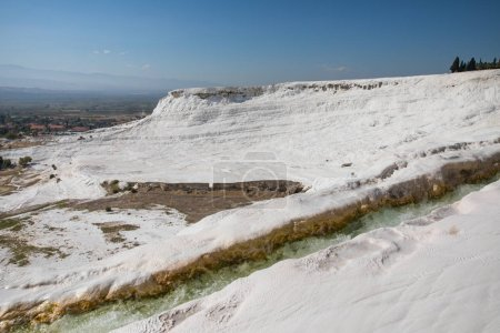 spectacular view of famous white geological formations in pamukkale, turkey