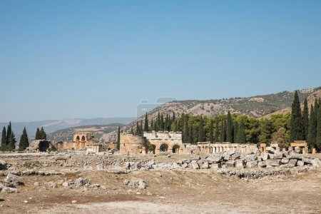 Photo for Beautiful ancient architecture and mountains behind in pamukkale, turkey - Royalty Free Image