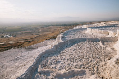 Photo for Beautiful scenic view of white limestone and majestic landscape in pamukkale, turkey - Royalty Free Image