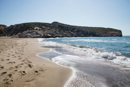 Photo for Footprints on sandy beach and beautiful sea waves, patara beach, turkey - Royalty Free Image