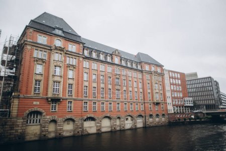 Photo for Urban scene with river and buildings at old warehouse city district in hamburg, germany - Royalty Free Image
