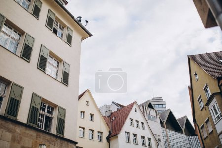 Photo for Low angle view of buildings and cloudy sky in stuttgart city, germany - Royalty Free Image