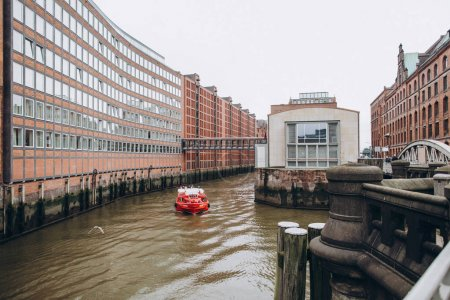 HAMBURG, GERMANY - SEP 4, 2016: Urban scene with river and old warehouse city district in hamburg, germany