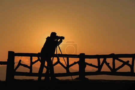 silhouette of a photographer who