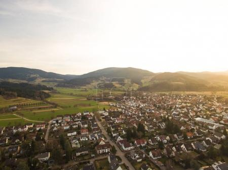 Photo for Aerial view of landmark with town and hills with backlit, Germany - Royalty Free Image