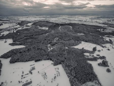 aerial view of beautiful winter landscape with snow-covered trees and fields, Germany