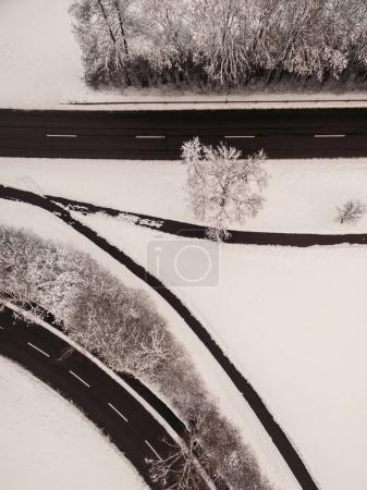 Photo for Aerial view of empty freeway and snow-covered trees at winter, Germany - Royalty Free Image