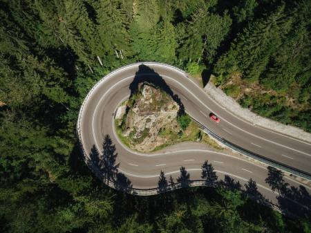 Photo for Aerial view of road going around rock in forest - Royalty Free Image