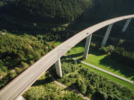 Photo for Aerial view of bridge over beautiful green forest - Royalty Free Image