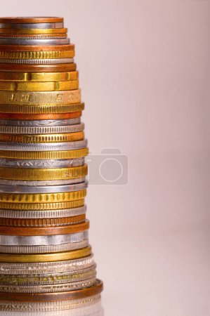 Vertical photo of coins stacked