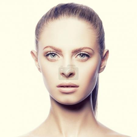Portrait of young woman with natural makeup