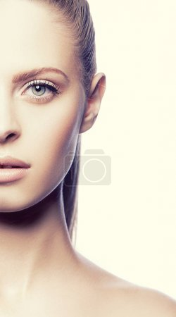 Photo for Half of face of young woman with natural makeup - Royalty Free Image